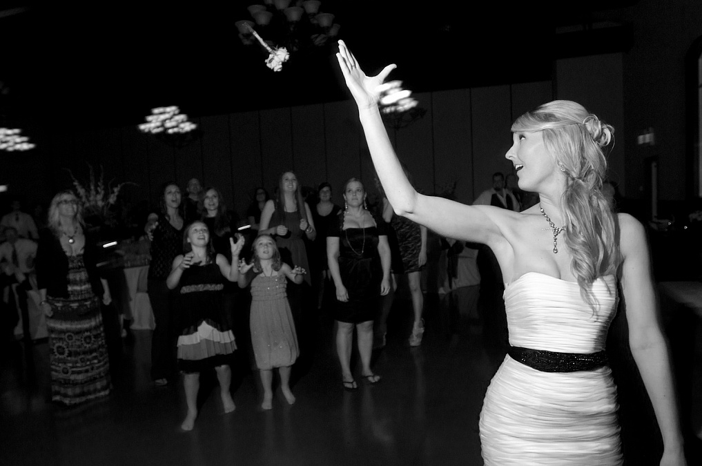 Bouquet toss during the wedding reception.