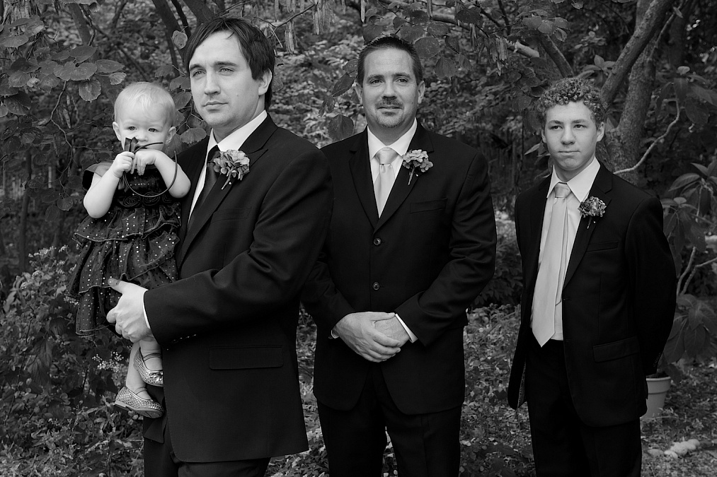 Joel, his daughter and groomsmen await the start of the wedding ceremony at Gazebo on the Green in Iowa City, Iowa.