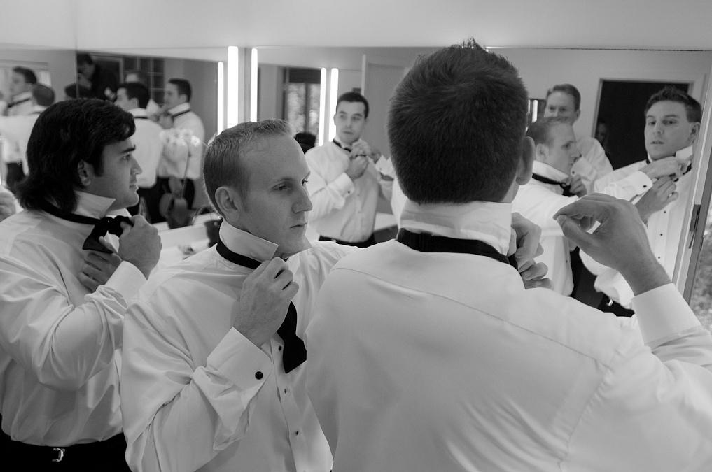 Wedding coverage of ceremony in Cedar Rapids, Iowa. Photojournalistic wedding photography in Eastern Iowa provided by David Greedy.